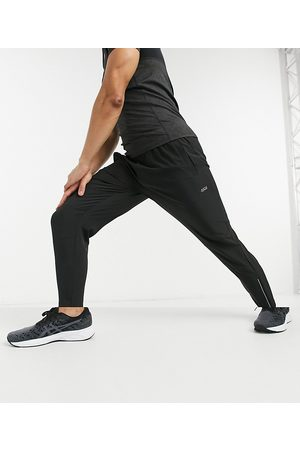 ASOS Woven skinny tapered running joggers with reflective zip detail