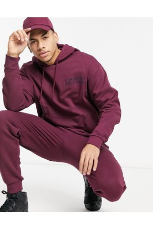 ASOS Men Tracksuits - Oversized tracksuit with embroidery in burgundy