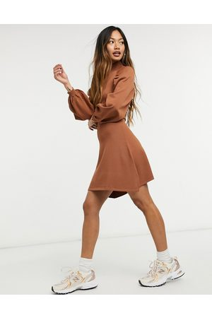 ASOS Knitted fit and flare dress with pleat sleeve detail in camel