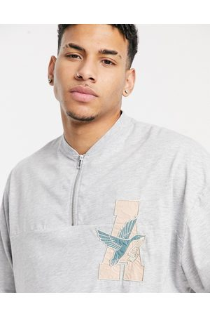 ASOS Oversized half zip t-shirt with chest logo in marl