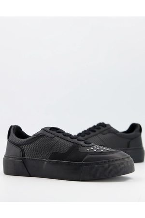 ASOS Snake print trainers in with studs
