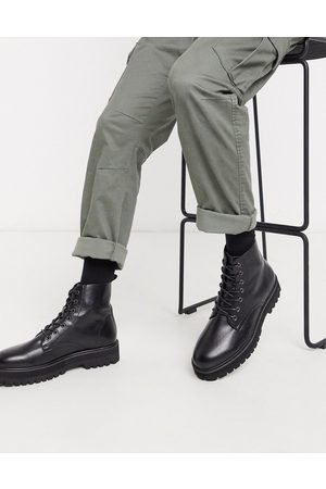 ASOS Vegan lace up boot in faux leather with raised chunky sole