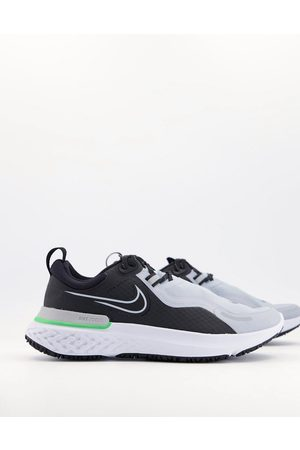 Nike React Miler Shield trainers in