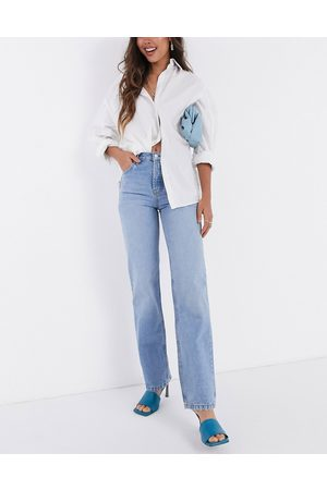 ASOS DESIGN Mid rise '90's' straight leg jeans in midwash