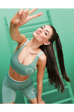 ASOS Sports bra with striped strap in recycled polyester