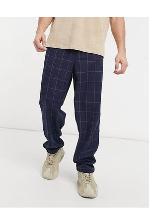 ASOS DESIGN Baggy fit trousers in navy window pane check