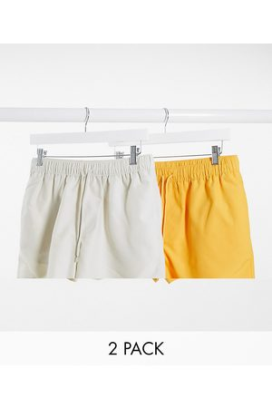 ASOS 2 pack swim shorts in beige and yellow short length save