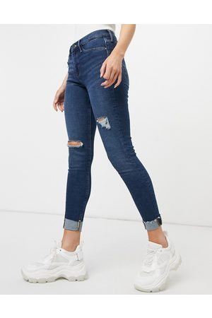 River Island Molly ripped raw hem skinny jeans in dark auth