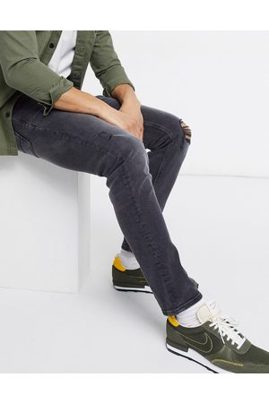 ASOS Men Slim - Stretch slim jeans in washed with knee rip and abrasions