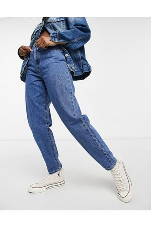 Levi's Women Tapered - Levi's high loose tapered leg jeans in mid wash