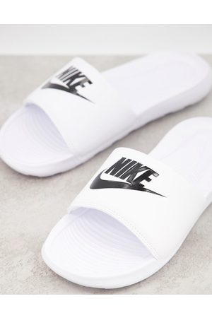 Nike Victori One sliders in white