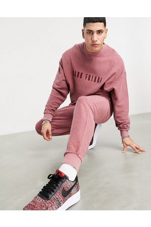 ASOS Tracksuit in reverse wash with embroidered logo in pink