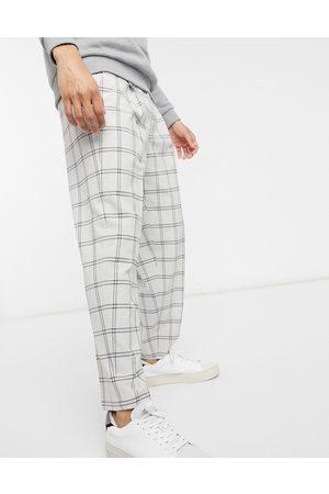 ASOS DESIGN Oversized tapered smart trouser in check