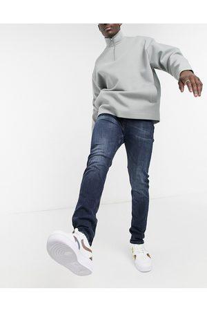 Calvin Klein Slim tapered jeans in black wash