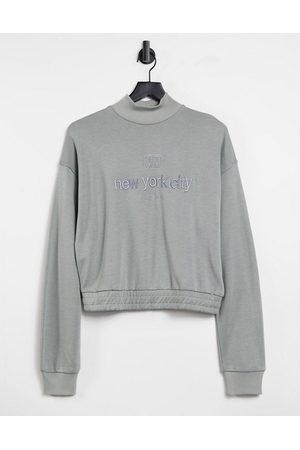 River Island New York slogan cropped high neck sweatshirt in