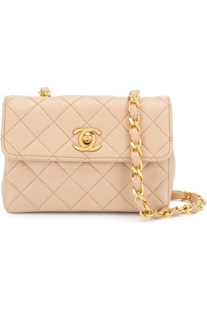 CHANEL 1990 diamond-quilted mini bag