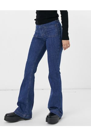 River Island Front pocket flared jeans in mid auth