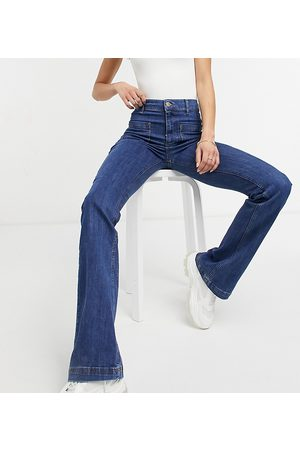 River Island Tall Pocket front flared jeans in mid auth