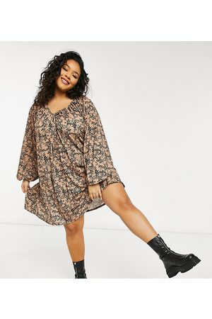 ASOS Curve ASOS DESIGN Curve mini smock dress with long sleeves and tie neck detail in animal print
