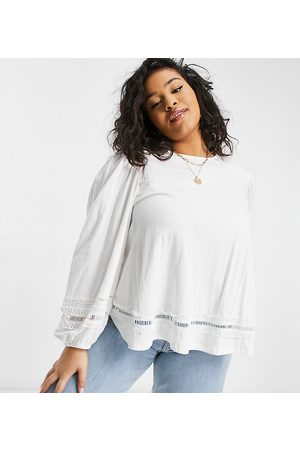ASOS ASOS DESIGN Curve trapeze top with lace trim and long sleeve in