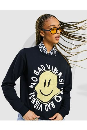 ASOS Oversized sweatshirt with happy vibes print in