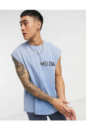 ASOS Oversized vest in acid wash with text chest print