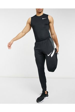 Nike Strike 21 joggers in and white
