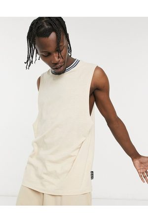ASOS Relaxed vest in with tipping and branded patch