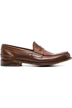 Premiata Crossover-strap leather loafers