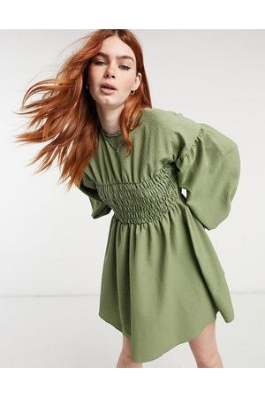 ASOS DESIGN Shirred bust mini dress in texture in khaki