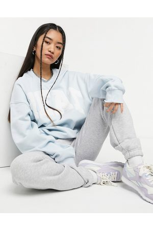 Weekday Pam organic cotton oversized sweatshirt with embroidered slogan in light blue