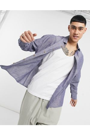 ASOS DESIGN 90s oversized linen shirt with pockets in