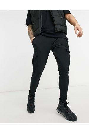 The Couture Club Slim fit textured cargo joggers in