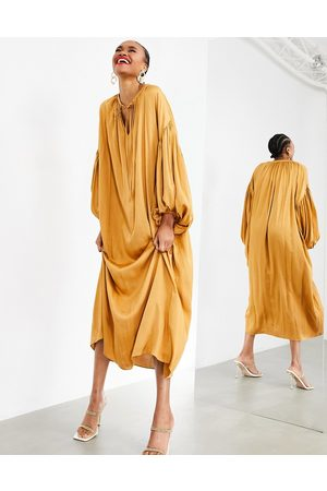 ASOS EDITION Oversized maxi dress with blouson sleeve in caramel