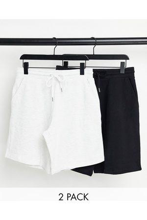 ASOS DESIGN Oversized jersey shorts in black/ white marl 2 pack