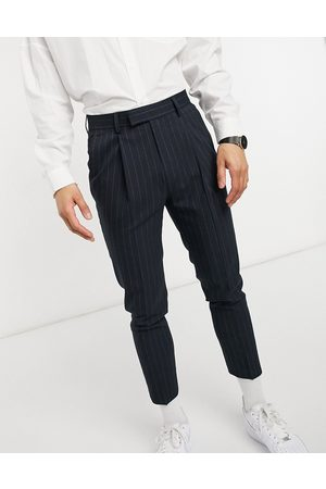 ASOS DESIGN Tapered pin stripe smart trousers in