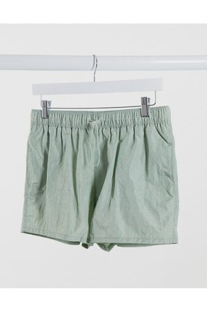 ASOS DESIGN Swim shorts in crinkle texture with toggle fastening in short length