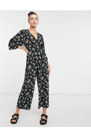 ASOS DESIGN Kimono sleeve v neck jumpsuit in dark floral print