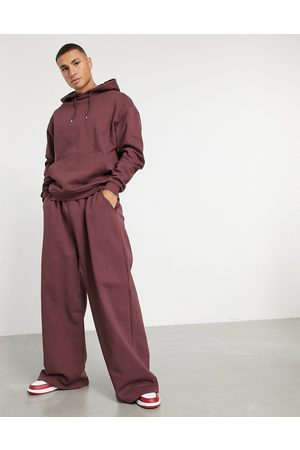ASOS DESIGN Oversized tracksuit with hoodie and oversized wide leg jogger in burgundy