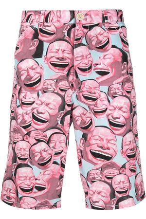 Comme des Garçons Men Bermudas - Laughter print shorts