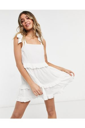 adidas Textured ruffle swing mini sundress with tie straps in
