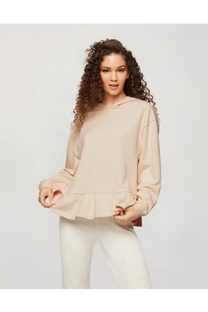 adidas Women Sweatshirts - Hoodie with ruffle hem in cream