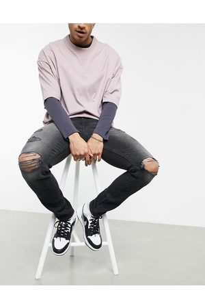 ASOS Men Skinny - Skinny jeans with 'less thirsty' wash in with heavy rips