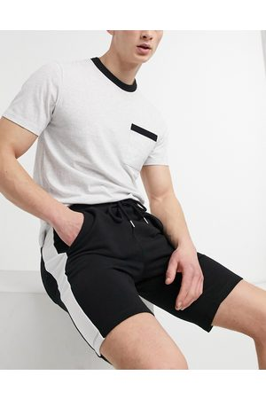 ASOS Jersey skinny shorts with side stripe in