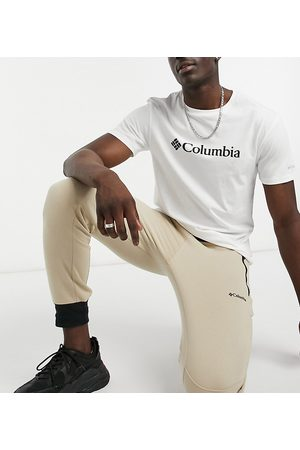 Columbia Freemont joggers in Exclusive at ASOS-Cream