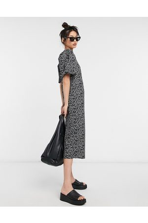 VILA Midi dress with puff sleeves in ditsy floral print-Multi