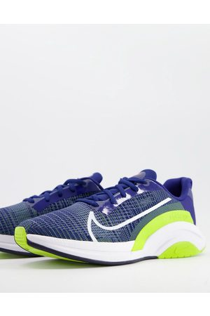 Nike Training SuperRep Surge trainers in blue