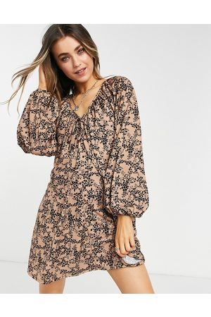 ASOS Mini smock dress with long sleeves and tie neck detail in animal print