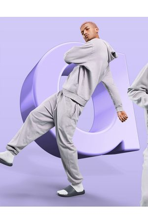 ASOS Relaxed jogger in lilac wash with logo