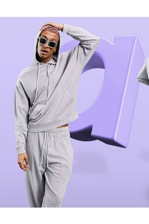 ASOS Oversized hoodie in lilac wash with chest logo